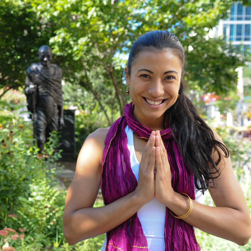 Alexandra Voukitchevitch with namaste mudra by the Ghandi statue in Union Square