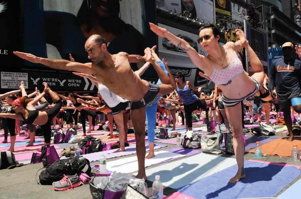 Bikram yogis practicing upward bow pose