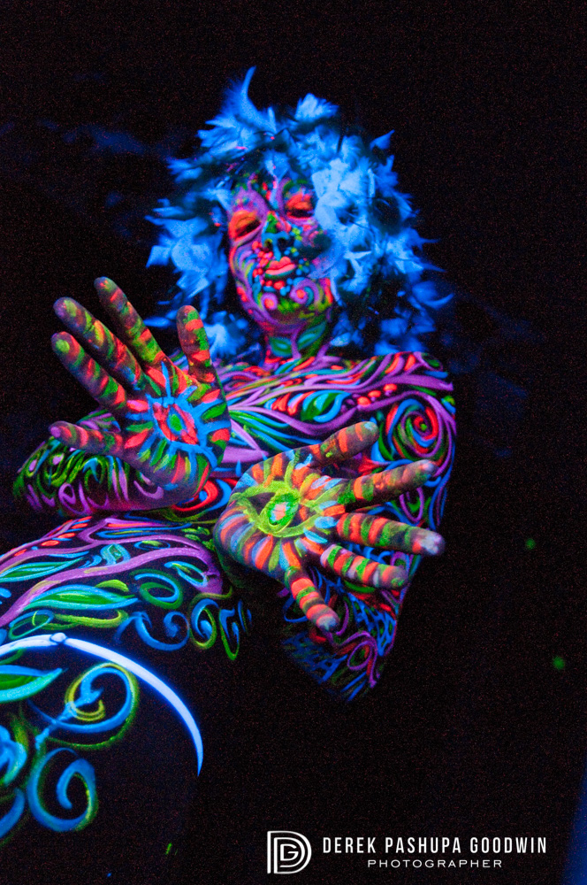 black light photograph hands and torso