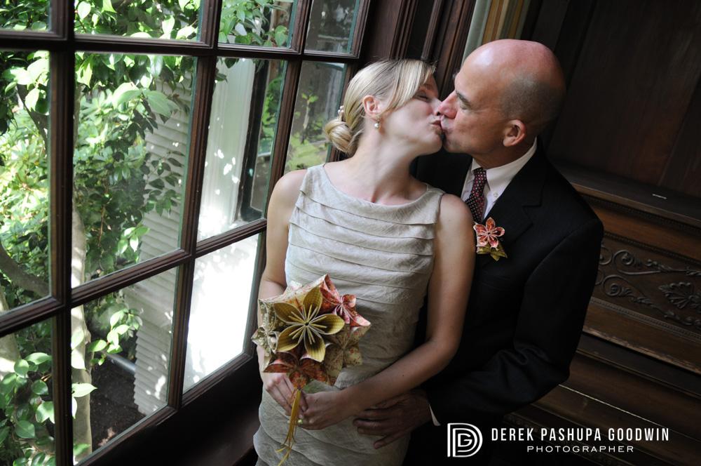 Morgan & Peter kissing by window