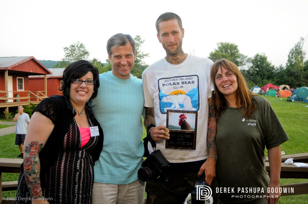 Jasmine Singer, Gene Bauer, Greg Straight Edge with Friend of Farm Animals award, and Susie Coston