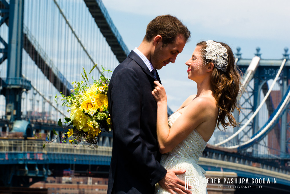 The bride and groom on the ReBar rooftop with the Manhattan Bridge in background