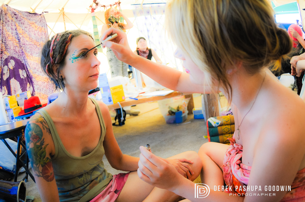 The bride having her makeup done before ceremony