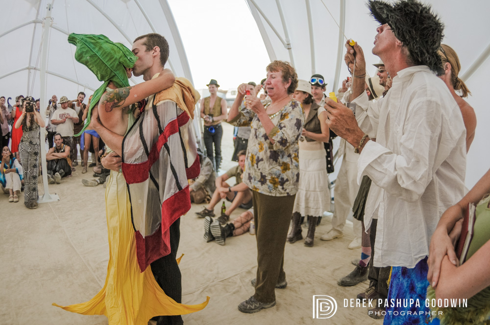the bride and groom kiss at burning man wedding