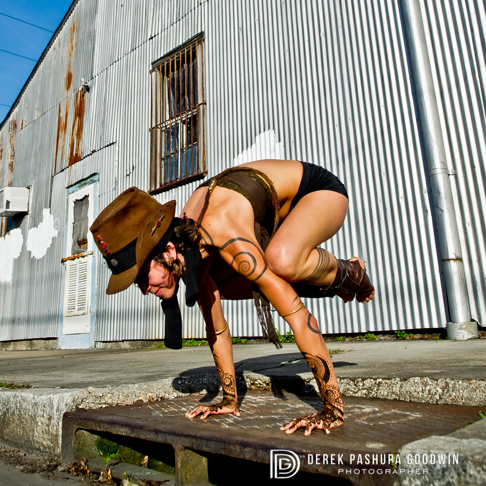 #3 Crow Pose (Bakasana) - This photograph is was taken of Leah Song in New Orleans. Leah is one of the sisters and vocalists in the band Rising Appalachia. I was collaborating with my friend New Orleans Henna to do yoga photos with henna. The henna is on Leah's hands, the rest of her tribal body art is tattoos!