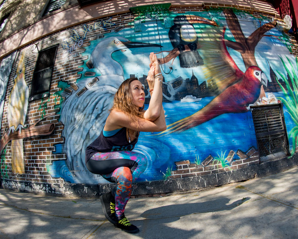 Garudasana |Eagle Pose - I took this photo of yogi surfer April Joy practicing Garudasana in NYC's Lower East Side.In his article 10 Best Yoga Poses for Surfers,Jack Albritton writes,