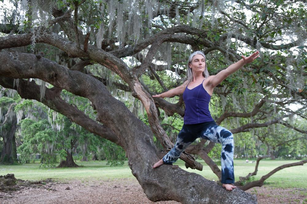 Virabhadrasana II | Warrior 2 - I captured this photo of yogi Cat McCarthypracticing Virabhadrasana II at the Tree of Life in New Orleans' Audubon Park.In the blog post 10 Best Yoga Poses for Surfers,Jack Albritton writes,