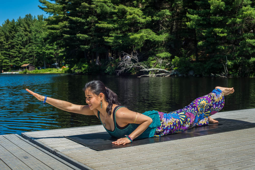 Shalabasana | Locust Pose - This photo is my fiancée Siewli Stark at Unifier Festival, where we fell in love. Awwww.In 7 Yoga Poses That Will Keep You Surfing Longer Sessions we learn that