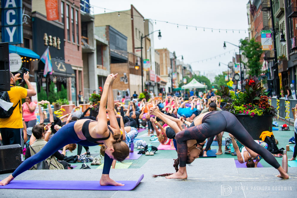 Anastasia Sushchenko  and  Elizabeth Caroline White  demonstrate asana during Jai Sugrim's class at Yoga Fest Jersey City