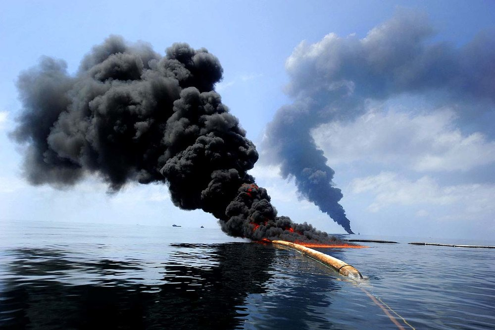 Dark clouds of smoke and fire emerge as oil burns during a controlled fire in the Gulf of Mexico, May 6, 2010. The U.S. Coast Guard, working with BP, local residents and other federal agencies, conducted the burn to help prevent the spread of oil following the explosion on Deepwater Horizon, an offshore drilling unit.