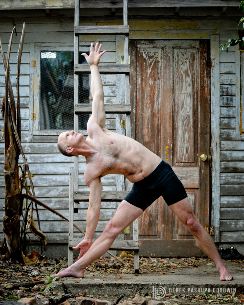 Andy Craig in triangle pose / trikonasana