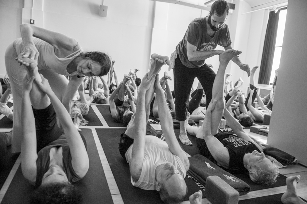 Sharon and Christian giving yoga assists