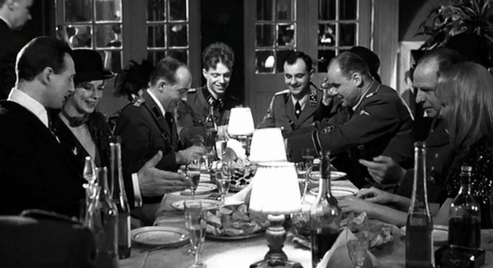 In the film Schindler's List, Oskar Schindler (portrayed by Liam Neeson) often attended such dinner parties, and was served by a Jewish maid.