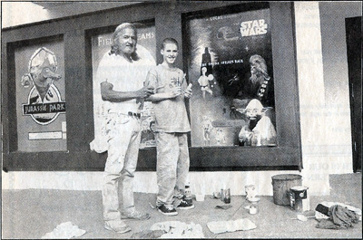 Arthur Longoria & Jason Long stand in front of their work in progress, Oct 1994
