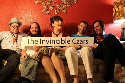 "The Invincible Czars make quirky, bold music for lovers of everything in the ""other"" category. Inspired by comics, sci-fi, fantasy & horror stories, cartoons, comedians, and classical composers, they're eclectic, dynamic and always have a cinematic flair. In 1998, guitarist Josh Robins started recording musical themes into his four-track recorder that sounded more like bits of movie scores than indie rock songs. He needed more than the usual guitar, bass, and drums to realize these budding rock symphonies; he taught himself to read music, began writing pieces for instruments he couldn't play, and eventually assembled the first line-up of The Invincible Czars. Since those early days, the Invincible Czars have evolved from a novel act in Austin's Red River scene to a reverse classical-crossover powerhouse playing all over the US, blending influences as disparate as Tchaikovsky and Van Halen. Whether they're playing a rock show in a club, a live silent film soundtrack in a theater, or a holiday event in a park, The Invincible Czars are always entertaining and out of the ordinary. Their musicianship is complemented with humor, magic tricks, fun and wacky wardrobe, and occasional minor acrobatics."