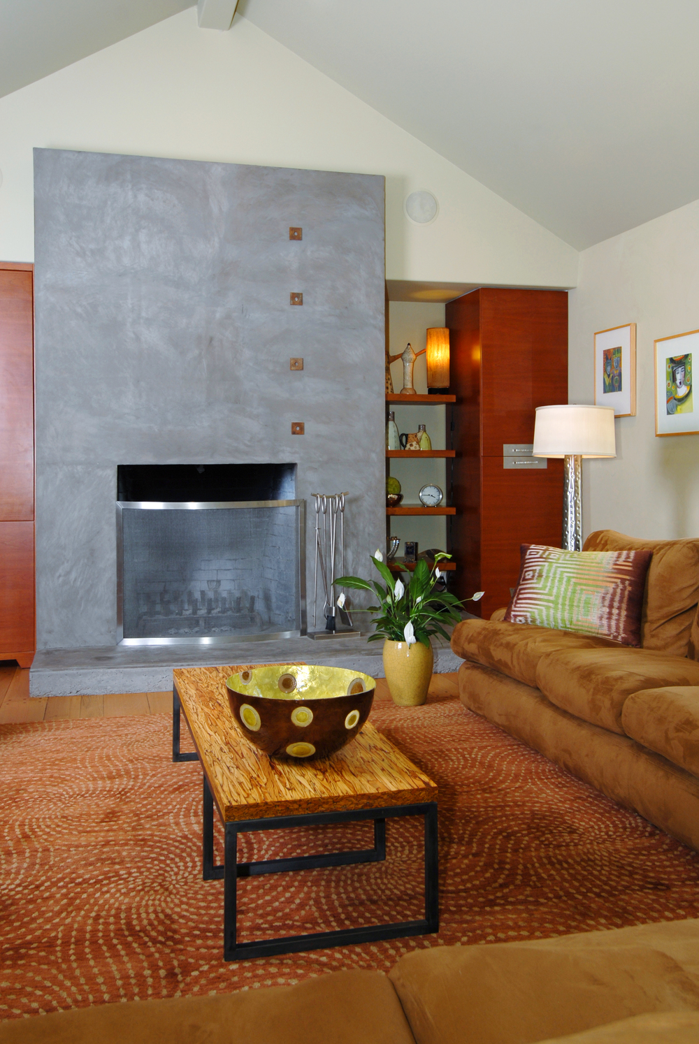 Concrete fireplace in cottage remodel