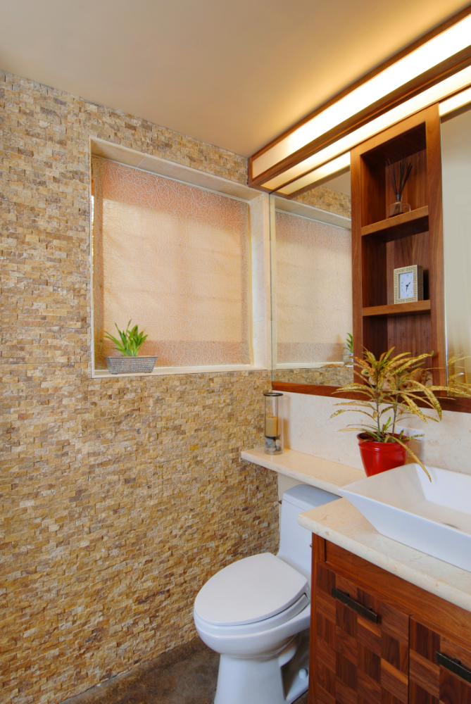 Zen bath with split-face travertine wall, custom walnut vanity and mirrored lighting/cabinet in a very small bathroom
