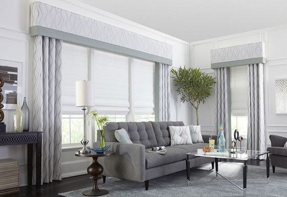 These upholstered cornices complete this elegant living room setting