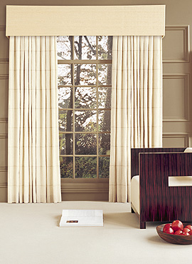 An upholstered cornice box gives these drapes a finished look
