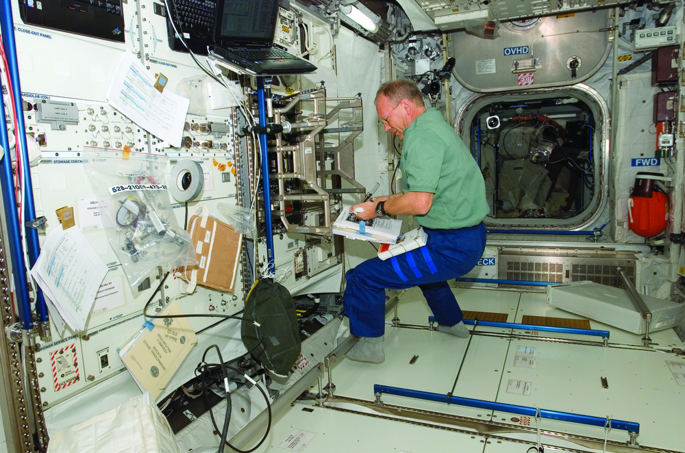 Astronaut working inside the ISS