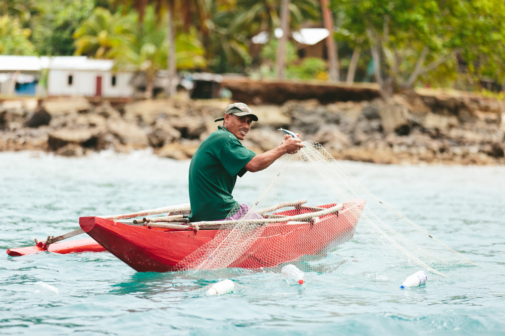 Fishing from a Dugout Canoe - The Remote Resort Fiji Islands