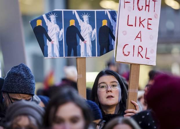 'The Trump-Statue of Liberty image of a solidarity march in Brussels' source: AP/Geert Vanclen Wijingaert.