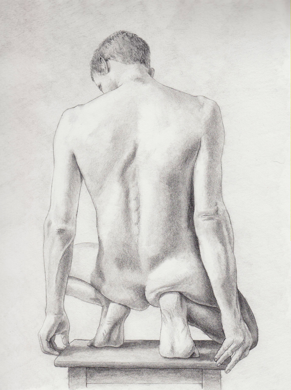 Male figure squatting