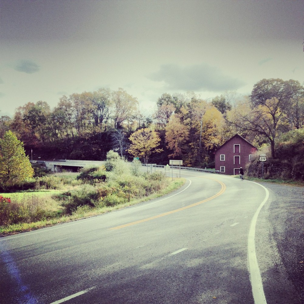 The roads continued to go up and down and we passed the Locust Creek Covered Bridge, which lifted our tired bodies for a few as we stopped and took in the scene.
