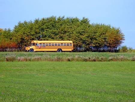 22784094-school-bus-on-a-country-road.jpg