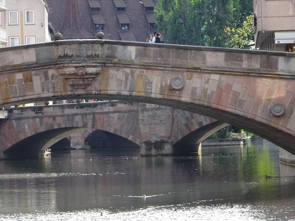 A view along the river from an island shows the congestion of bridges there is through Nuernberg.