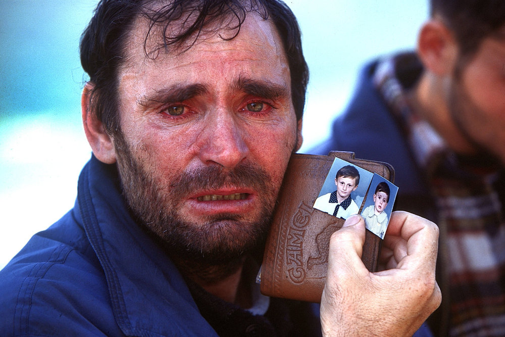 "Kosovar-Albanian refugee, 1999<span class=""photo-essays-link""><span class=""separator"">・</span><a href=""/photo-essays"">Photo-essays</a></span>"