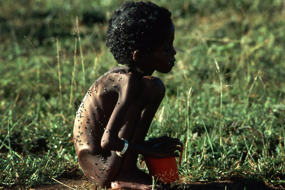 "Ethiopian refugee, 1986<span class=""photo-essays-link""><span class=""separator"">・</span><a href=""/photo-essays"">Photo-essays</a></span>"