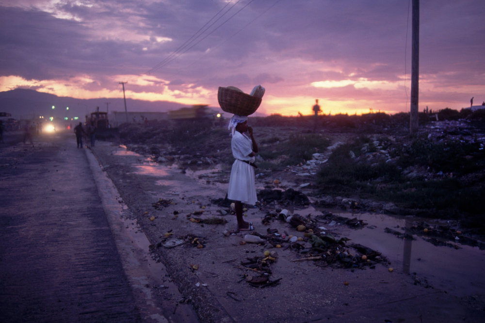 "Cité Soleil, Port-au-Prince, Haiti, 1994<span class=""photo-essays-link""><span class=""separator"">・</span><a href=""/photo-essays"">Photo-essays</a></span>"