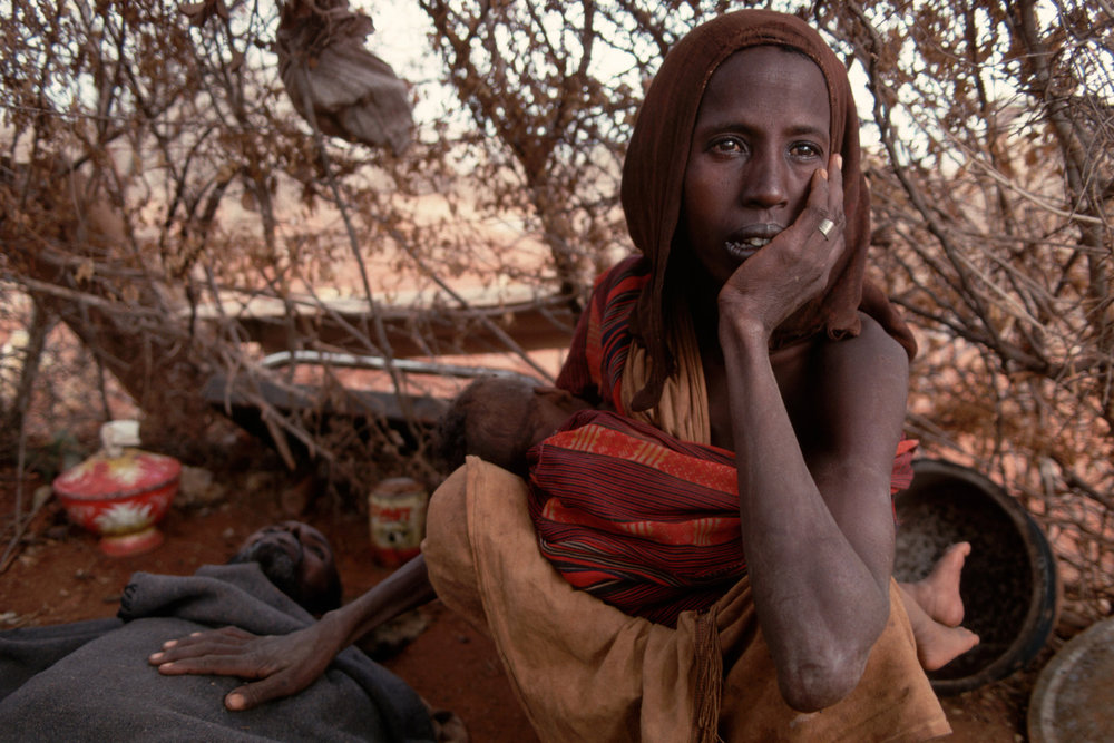 "Famine crisis. Baidoa, Somalia, 1992.<span class=""photo-essays-link""><span class=""separator"">・</span><a href=""/photo-essays"">Photo-essays</a></span>"
