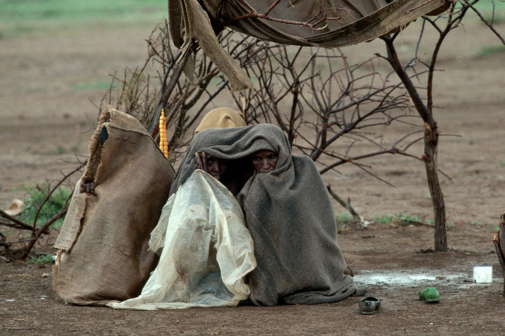 "Ethiopian refugees. Togwajaale, Somalia, 1986.<span class=""photo-essays-link""><span class=""separator"">・</span><a href=""/photo-essays"">Photo-essays</a></span>"