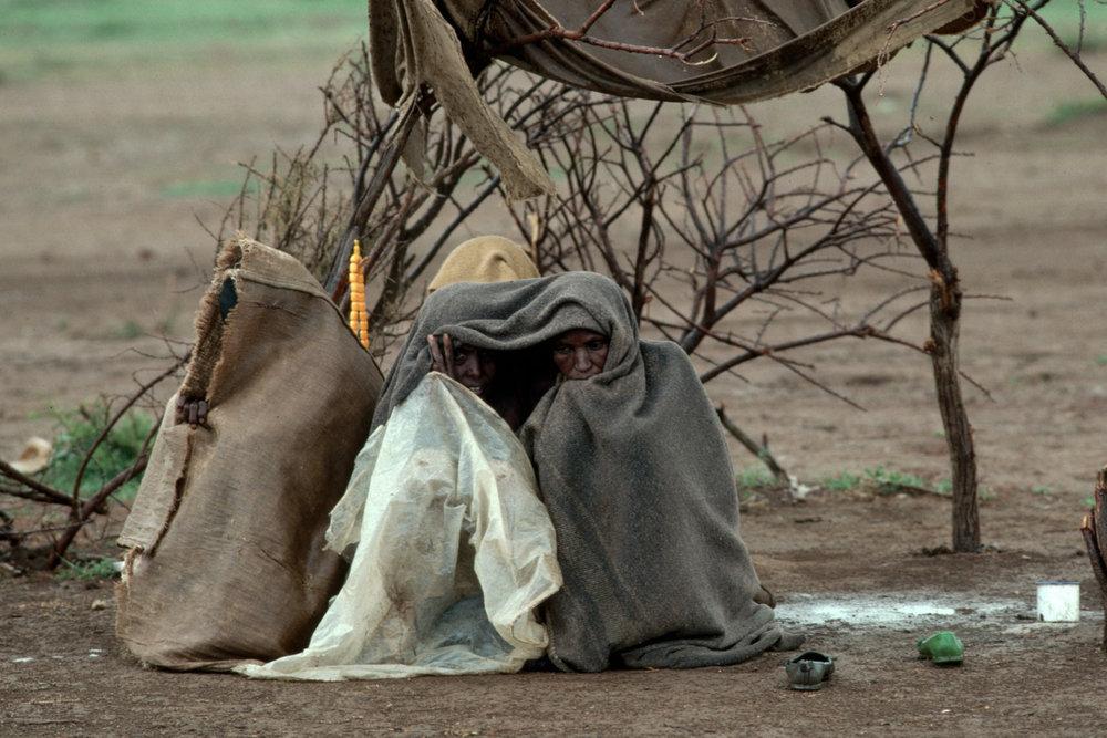 "Ethiopian refugees. Togwajaale, Somalia, 1986.<span class=""photo-essays-link""><span class=""separator"">・</span><a href=""/photo-essays"">Photo-essays</a></span>"