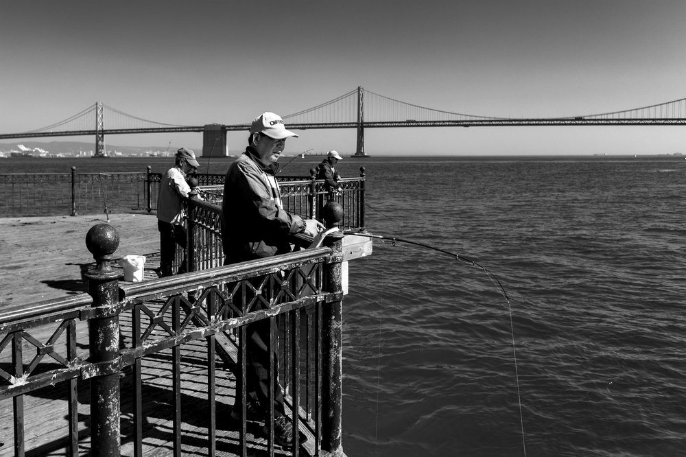 158_Scussel - Long Pier Fisherman B&W.jpg