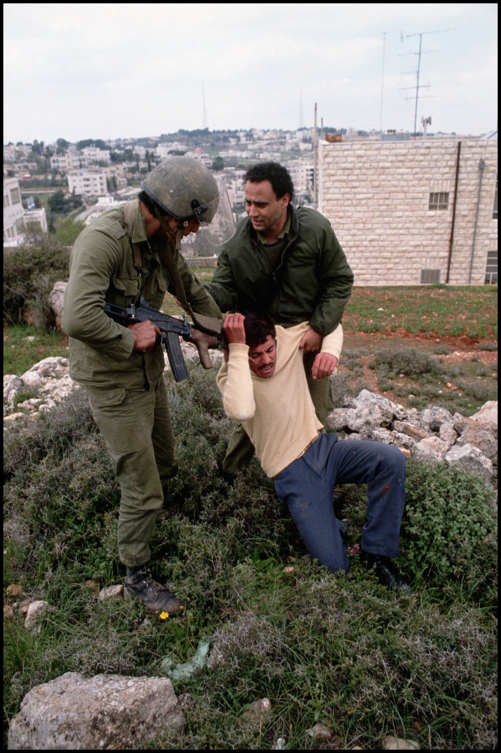 1988, Ramallah, West Bank --- Two Israeli soldiers arrest a Palestinian during the Intafada in Ramallah on the West Bank.