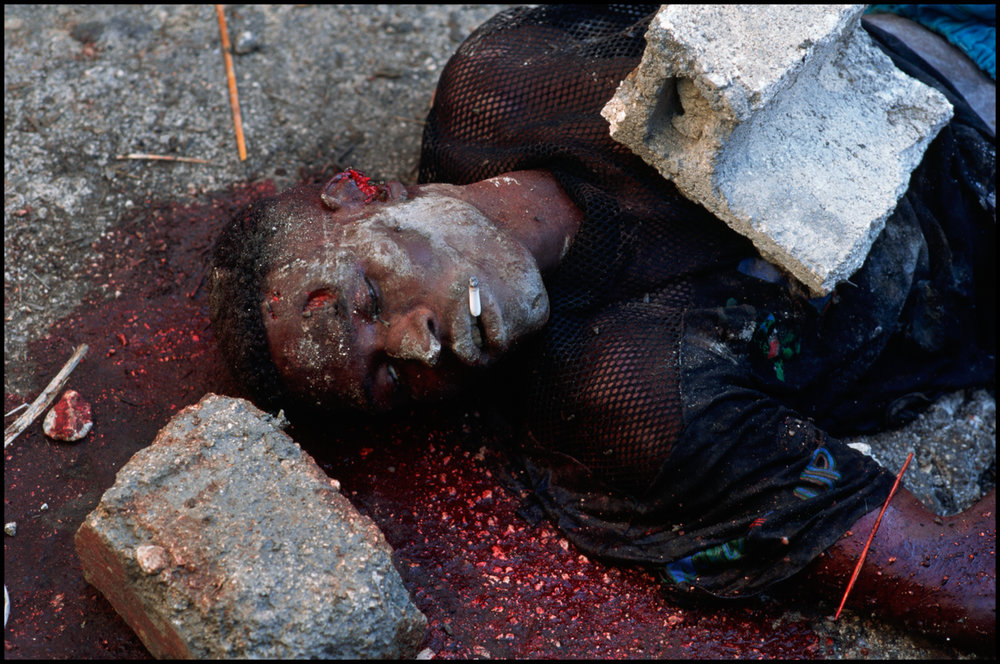 1994, Port-au-Prince, Haiti --- An alleged member of the Tonton Macoute has been stoned to death a few days before the return of Aristide to power in Haiti.