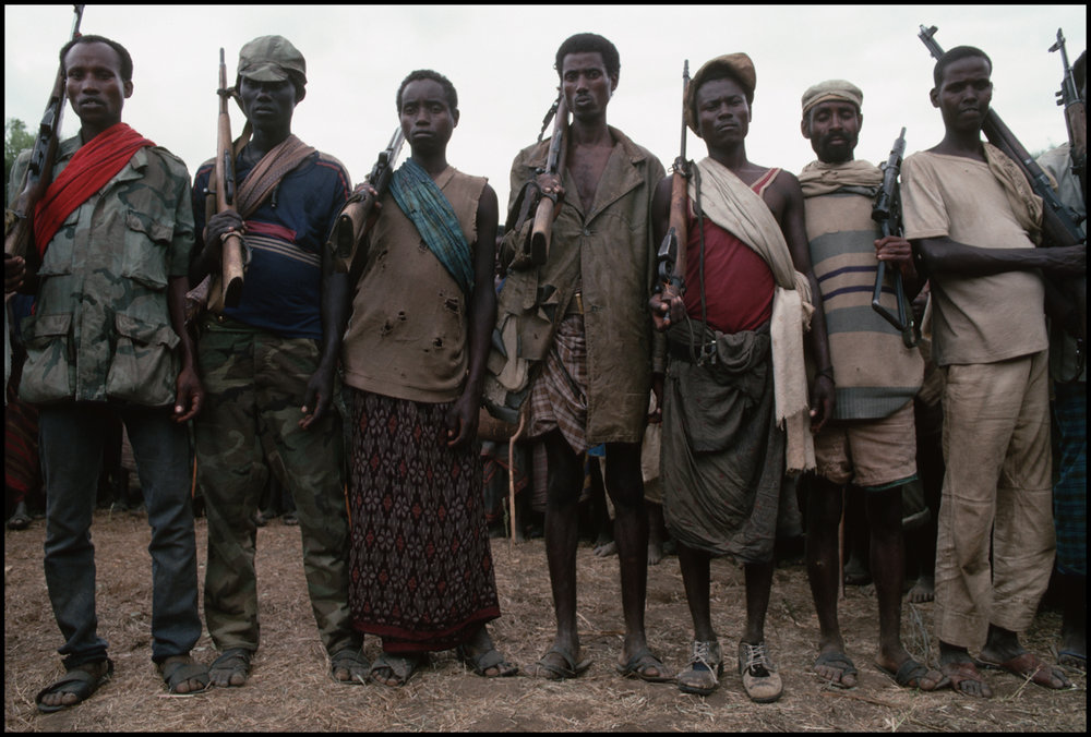 August 1992, Hawaye, Somalia --- Somali militamen, part of a factional group fighting during the civil war, stand in line at the village of Hawaye, near Baidoa