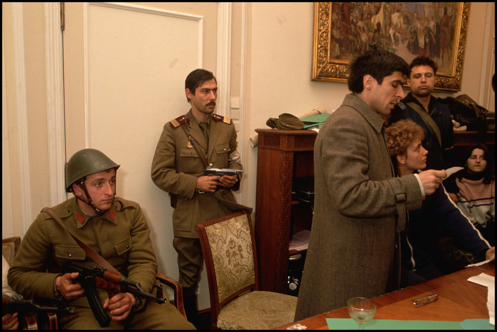 December 1989, Bucharest, Romania --- Romanian revolutionaries occupy Nicolae Ceausescu's own office in December 1989, following his failed attempt to flee the country.