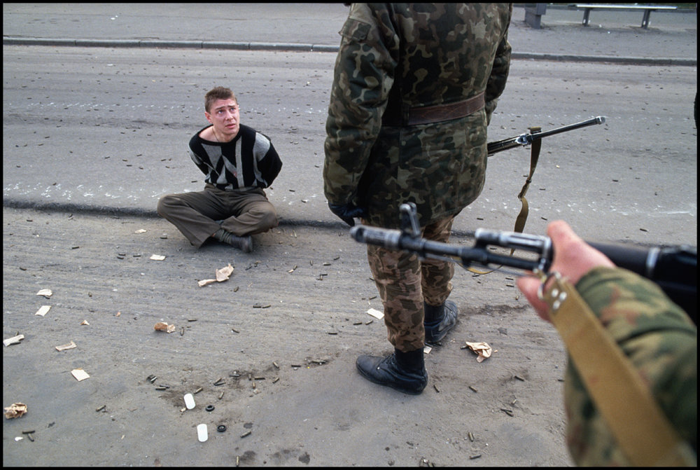 04 Oct 1993, Moscow, Russia --- A man sits in a street after being arrested by soldiers during the violent conflict at the Russian White House on October 4, 1993.