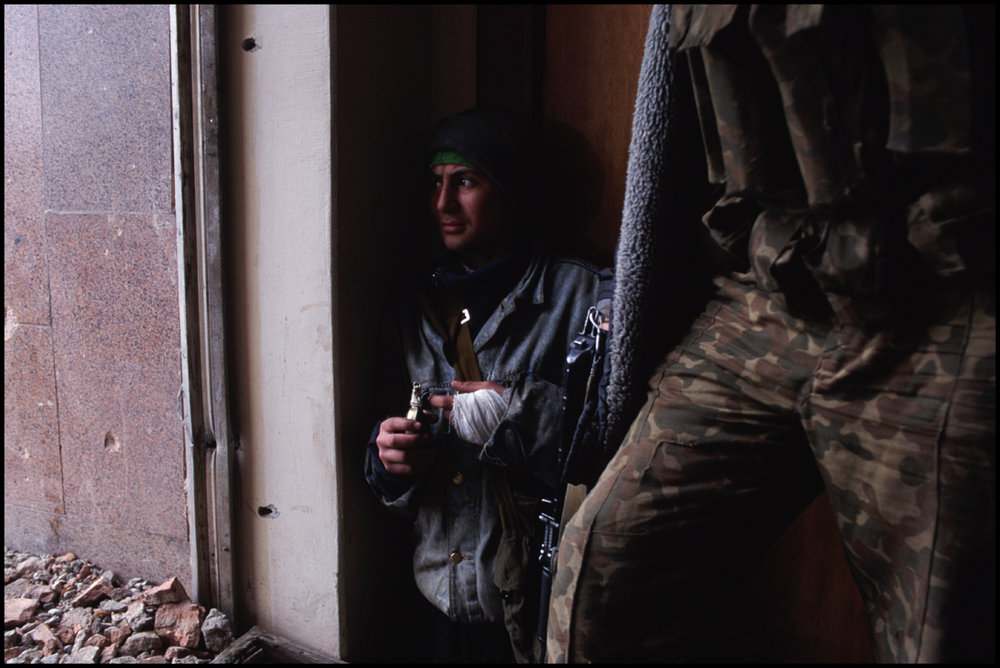 ca. 1995, Grozny, Russia --- Chechen rebels hide inside the Presidential Palace during heavy shelling by the Russians. The rebels are fighting Russian troops for the independence of Chechnya