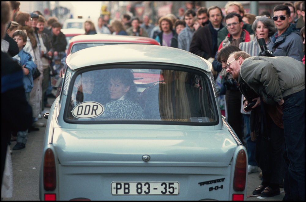 12 Nov 1989, West Berlin, West Germany --- A crowd of West Germans welcome the first travelers from the east since reunification of the country.