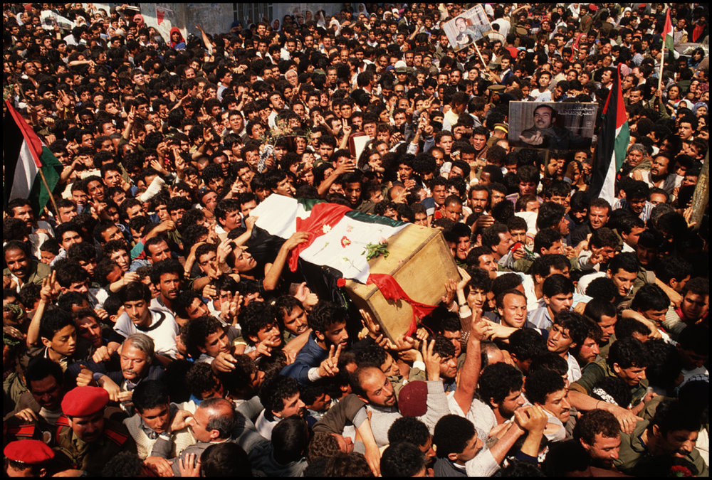 20 Apr 1988, Damascus, Syria --- Throngs of mourners follow the coffin of Abu Jihad, a PLO commander assassinated by the Israelis, through the streets of Damascus