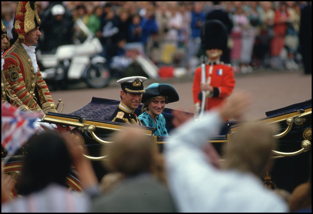 23 Jul 1986, London, England, UK --- Prince Charles and Princess Diana ride in a procession through London after the wedding of Prince Andrew and Sarah Ferguson
