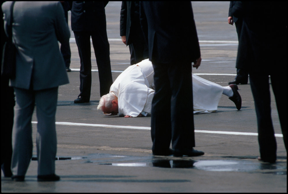 08 Jun 1987, Warsaw, Poland --- In a traditional gesture, Pope John Paul II kisses the ground after deplaning in Warsaw for an official visit