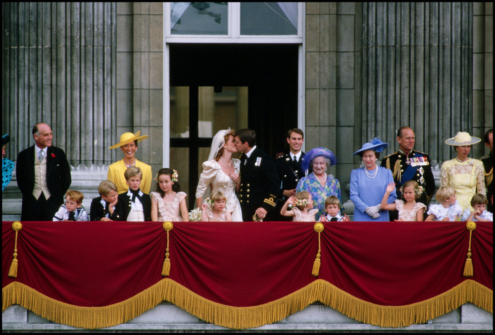 ca. 1986, London, England, UK --- The Duke and Duchess of York and their wedding party stand on the balcony of Buckingham Palace after their wedding