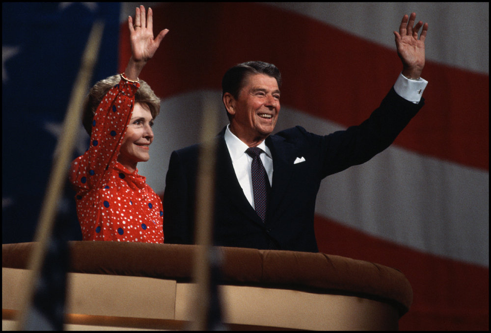 1984, Dallas, Texas, USA --- US President Ronald Reagan and his wife Nancy wave from the podium at the Republican National Convention, where he is campaigning for a second term as President.