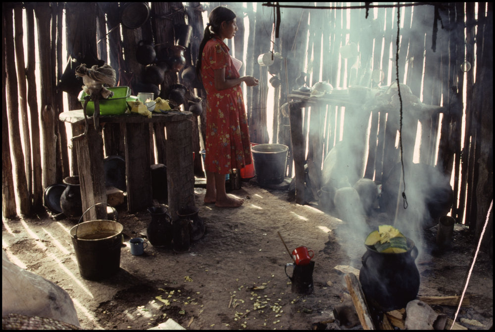 1988, Mexico --- Guatemalan Refugee Cooking in Home